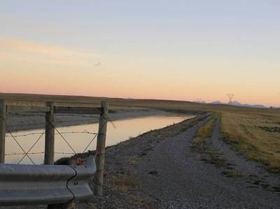 Photo of the irrigation channel north of Head-Smashed-In Buffalo Jump near Township 102, which is used to divert water from nearby watercourses for use in agricultural irrigation.